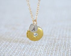 Locket Necklace in Gold and Brass - My girl asked for a locket for Christmas and a locket she shall receive:)