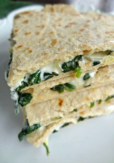 Spinach & Artichoke Quesadillas-a super simple to make recipe for a delicious vegetarian appetizer or even lunch entree!