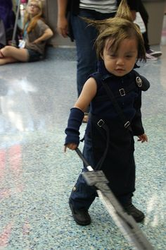 Anime Expo 2012 - little Cloud Strife (Final Fantasy VII) cosplay. Oh the adorableness and gravity-defying hair!!!