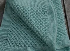 The popcorn baby blanket -- one of our easy knitting patterns that make an adorable baby blanket that's sure to be treasured for a long time! Baby Knitting Patterns, Free Baby Blanket Patterns, Afghan Patterns, Knitting Stitches, Baby Patterns, Crochet Patterns, Sewing Patterns, Crochet Ideas, Knitted Baby Blankets