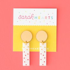 Modern white and mirrored gold acrylic earrings with polka dot pattern by Sarah Hearts. The perfect playful statement earrings for everyday.