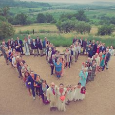 This would be great way for a large group of people to pose for a photo   Would work for family & friends' celebrations & corporate events ...you just have to figure out how you want the people to be positioned ( for instance do you want everyone to form the letter C, or do you want everyone to form a circle)      wedding-photo-idea-heart