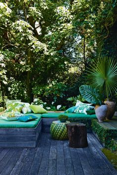 Bring the tropics to your backyard oasis by adding tropical prints, colors, and accents like potted Palms, Cannas, or ??? Even the well-established, woodland themed trees lend a private & lush backdrop.