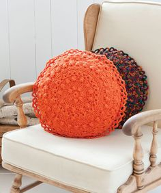 Free pattern @ Red Heart for Puff Stitch Round Pillows - would look lovely in soft grey or peach.