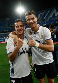 Cristiano Ronaldo of Real Madrid and Lucas Vazquez of Real Madrid celebrate being crowned champions following the La Liga match between Malaga and Real Madrid at La Rosaleda Stadium on May 21, 2017 in Malaga, Spain.