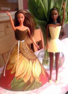 Forget buying expensive Barbie clothes.  Here's a great video guide on how to make them from wallpaper!