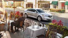 2015 Buick LaCrosse luxury mid-size sedan driving on the street.