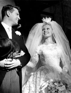 "Pretty long sheer Pronuptia de Paris lace wedding dress bridal gown. Brigitte Bardot on the set of ""Voulez-vous danser avec moi"" directed by Michel Boisrond France 1959bri"