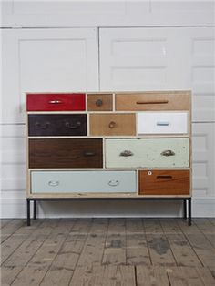 Unique piece of furniture made from lots of different sized drawers. Right now we have lots of drawers for $2 each.