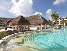 Experience the charm of Paradisus Playa Del Carmen La Esmeralda surrounded by the Caribbean's warm crystal blue waters #honeymoons #vacation