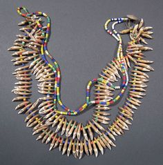 Papua New Guinea | This colorful necklace is made of teeth from the flying fox and glass seed beads. From the Sepik River area | 20th century | Sold