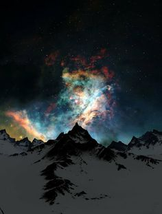 Aurora borealis over snow covered mountain tops