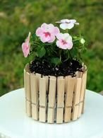make an adorable picket fence flower pot with clothes pins and a tin can