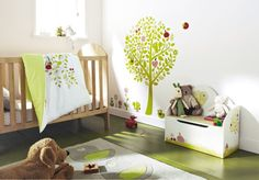 Green and white nursery with tree wall decal