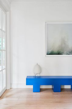 Cobolt blue bench. This Seaside Residence by Sally Caroline was a partial renovation of a grand Georgian home in the seaside town of Mount Martha in Victoria.: