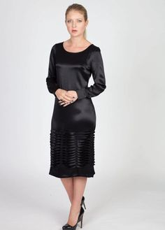 Black Midi dress by MenuchaB: - Made from a smooth premium silk - Special pleating detail on the bottom of the dress - Long sleeves - Midi length - Boat neckline - Shift Style - Regular fit, true to size - Zip back fastening - Fully lined Fab
