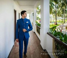 Blue bandhgala suit with a white pocket square