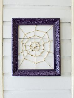 Spider Web Wreath - Spooky Front Porch Decorating Ideas for Halloween on HGTV