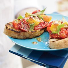 Grilled Tomato Crostini | The only way to grill tomatoes without losing their delicious juices is in a foil packet. Flavor the tomatoes with any fresh herbs or aromatics, then use them as a delicious crostini topper.