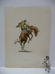 Vintage print Warming Up by Charley Paris Rodeo Bucking Horse and Cowboy. $20.00, via Etsy.
