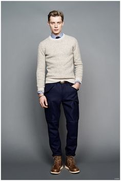 Shop this look on Lookastic:  https://lookastic.com/men/looks/crew-neck-sweater-dress-shirt-cargo-pants-boots-tie-belt/9371  — White and Blue Vertical Striped Dress Shirt  — Navy Tie  — Grey Crew-neck Sweater  — Dark Brown Leather Belt  — Navy Cargo Pants  — Brown Leather Boots