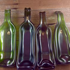 Upcycled Wine Bottles with 22 carat gold decal by AriGarDesigns