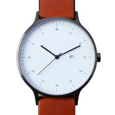 Instrmnt 01-A (gunmetal/tan) watch by Instrmnt. Available at Dezeen Watch Store: www.dezeenwatchstore.com
