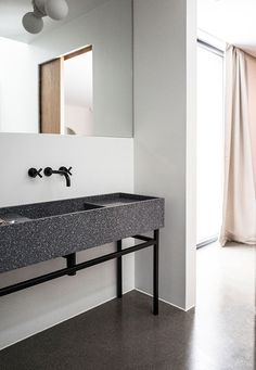 An hour north of Oslo, located on a majestic hill side facing the Norwegian woods and Mjøsa lake, lies the Gjøvik house; a modern and minimal cluster house created by Norm Architects. Minimalist Bathroom, Minimalist Home, Terrazzo, Cluster House, Studio Mk27, Norwegian House, Interior Minimalista, Contemporary Bathrooms, Modern Bathroom