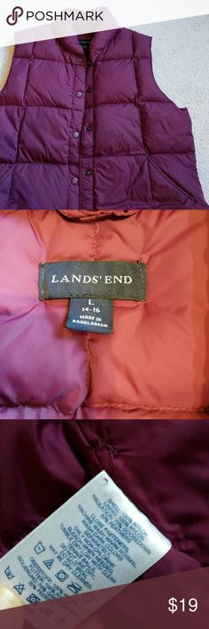 Land's end down vest Beautiful plum colored puffy vest from Land's end, size large. In like new condition because I bought the wrong size but just kept hoping it would fit. My loss is your gain!! It has really nice deep pockets and is 70% goose down feathers so it will be super toasty! Lands' End Jackets & Coats Vests