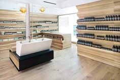 Aesop store by William O'Brien Jr., Boston . O'Brien Jr. inventively recast several characteristic historic design elements and paired these with new and reclaimed antique white oak, used for flooring and strikingly articulated shelves.