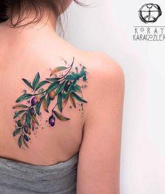 Koray Karagozler olive branch tattoo