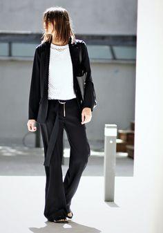 Black blazer, white mesh top, black trousers