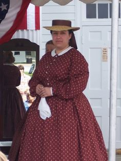 Cotton dress outfit finished off with a fashionable straw hat and handkerchief.