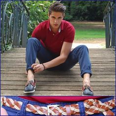 What a handsome-looking man. He's wearing: Tommy Hilfiger Bordeaux Polo, H Navy Blue Trouser, Docksides Sebago