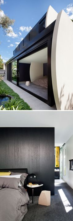 In this modern Australian house, large sliding doors open the bedroom up to the small backyard, and allow plenty of natural light to fill the bedroom.