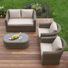 Maze Rattan Winchester 4 Piece Seating Group with Table and Cushions