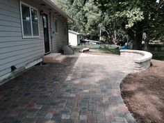 Cambridge cobble paver patio with sitting wall.  #TopekaLandscape