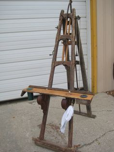 This is an easel that i made from an 1800's well drilling stand., there are several items that make this special. The crank on the side is symbolic of cranking out the paintings,  The value is for letting off steam, the pulley system is for the clean up rag