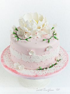 Beautiful sugar art on a pink cake, from Sweet Kingdom blog . . .