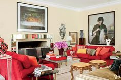 Vogue Brazil style director Donata Meirelles's historic São Paulo home, decorated by architect and designer Sig Bergamin, features several striking mirrored pieces, including the mantel and the Bergamin-designed cocktail table. The photographs are by Abelardo Morell (left) and Vik Muniz (far right), the sofas are upholstered in a Pierre Frey fabric, and the gilt-wood stools are 18th-century Italian.