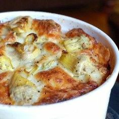 Artichoke Bread Pudding: puffy egg-y cheese-y bread pudding with garlicherbs and artichoke hearts