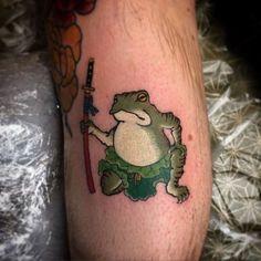 29 frog tattoo on hand