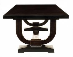 Art Deco Dining table with a two lyre supports which was originally designed by Jacques-Emile Ruhlmann for the Hotel Ducharne.   Veneered in Macassar Ebony, it features a stepped black lacquer edge and base. The definitive Art Deco lyre supports are decorated with silver detail.