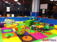 A colorful daycare play area using SoftTiles Die-Cut Circle 2x2 Foam Mats.