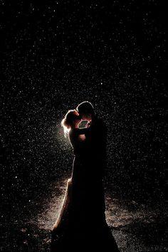 Rainy Night Kiss // Photo by M2 Photography  via Rustic Wedding Chic