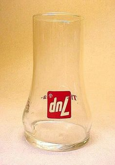 The upside down       7-up glass. So cool back then.