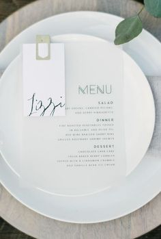 41 Edgy Modern Wedding Ideas You'll Love: simple modern place setting with a printed menu and neutral dishes