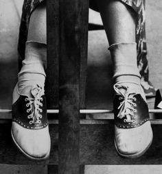 Black and white saddle shoes.
