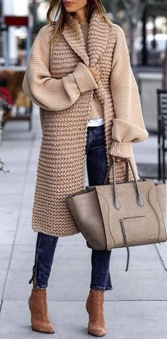 fashionable winter outfit / knit coat top bag jeans heels