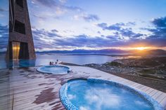 Outdoor swimming pool and jacuzzi at sunset, Hotel Arakur Ushuaia Resort and Spa, Ushuaia, Tierra del Fuego, Patago